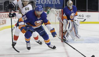 Florida Panthers' Jaromir Jagr (68) and New York Islanders' Johnny Boychuk (55) skate for control of the puck as Islanders goalie Thomas Greiss (1) watches during the first period of an NHL hockey game Wednesday, Jan. 11, 2017, in New York. (AP Photo/Frank Franklin II)