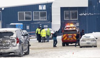 Emergency responders talk outside McNeilus Truck and Manufacturing after a possible explosion Wednesday, Jan. 11, 2017, in Dodge Center, Minn. (Andrew Link/Rochester Post Bulletin via AP)