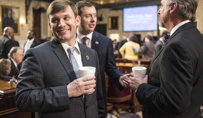 Rep. Russell Ott, D-Calhoun, left, and Rep. Jay Jordan, R-Florence, socialize before the state of the state address in the House chambers at the Statehouse, Wednesday, Jan. 11, 2017, in Columbia, S.C. (AP Photo/Sean Rayford)