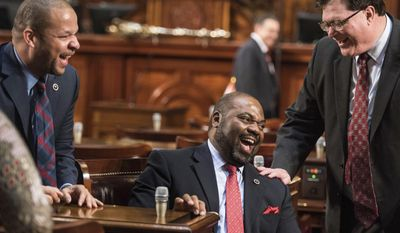 Rep. Samuel Rivers, R-Berkeley, center, laughs with Rep. Jay Lucas, R-Darlington, right, and Rep John King, D-York, left, before the state of the state address by Gov. Nikki Haley at the state Capitol, Wednesday, Jan. 11, 2017, in Columbia, S.C. (AP Photo/Sean Rayford)
