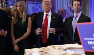 President-elect Donald Trump, accompanied by family members, waits to be introduced during a news conference in the lobby of Trump Tower in New York, Wednesday, Jan. 11, 2017. (AP Photo/Evan Vucci)
