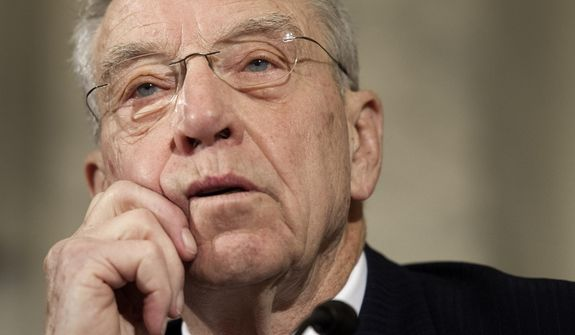 Senate Judiciary Committee Chairman Chuck Grassley, Iowa Republican, wants to slow down an investigation in order to take a thorough look at 35 pages of unsubstantiated, salacious opposition research by a former British intelligence officer that almost disrupted Donald Trump's presidential campaign. (Associated Press/File)