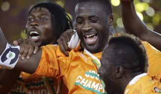 FILE - In this Sunday, Feb. 8, 2015 file photo, Ivory Coast's Yaya Toure, with teammates, celebrate after winning their African Cup of Nations final soccer match against Ghana in Bata, Equatorial Guinea. The African Cup of Nations returns to Gabon for the second time in five years with the kickoff on Saturday Jan. 14, 2017 and the final on Feb. 5. (AP Photo/Themba Hadebe, File)