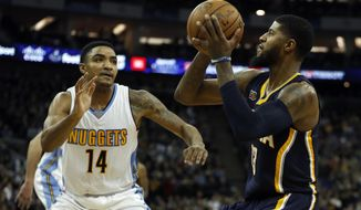 Denver's Gary Harris, left, tries to block Indiana's Paul George during the NBA basketball match between Indiana Pacers and Denver Nuggets in London, Thursday, Jan. 12, 2017.(AP Photo/Kirsty Wigglesworth)