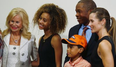 Annabelle Bowlen, left, wife of Denver Broncos owner Pat Bowlen, greets Nataly Joseph, second from left, as her brother, Stone, father Vance and mother Holly look on after Vance Joseph was introduced as the new head coach of the Denver Broncos during an NFL football news conference at the team's headquarters Thursday, Jan. 12, 2017, in Englewood, Colo. (AP Photo/David Zalubowski)