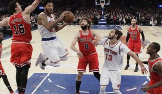 New York Knicks' Derrick Rose (25) drives past Chicago Bulls' Paul Zipser (16) as teammate Joakim Noah (13) and Robin Lopez (8) watch during the first half of an NBA basketball game Thursday, Jan. 12, 2017, in New York. (AP Photo/Frank Franklin II)