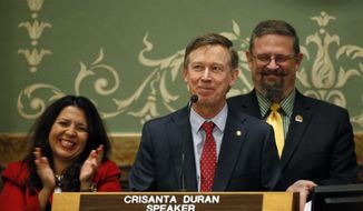 Colorado Gov. John Hickenlooper delivers his annual State of the State address to lawmakers and guests, inside the state legislature, Thursday, Jan. 12, 2017, in Denver. Behind him are, left to right, new House Speaker Crisanta Duran, D-Denver, and new Senate President Kevin Grantham, R-Canon City. (AP Photo/Brennan Linsley)