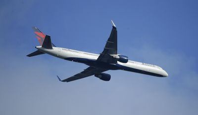 FILE - In this Sunday, March 6, 2016, file photo, a Delta Air Lines Boeing 757 flies overhead, in Seattle. On Thursday, Jan. 12, 2017, Delta Air Lines, Inc. reports financial results. (AP Photo/Ted S. Warren, File)