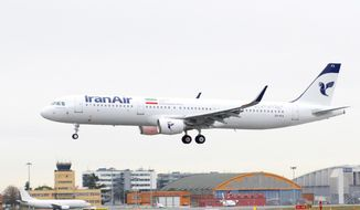 In this photo dated Wednesday, Jan. 11, 2016, provided by Airbus, shows an A321 with the Iran Air logo landing at Blagnac airport near Toulouse, southwestern France. Iran Air has taken delivery of its first new aircraft, an A321, in a hand over ceremony in Toulouse. (Herve Gousse/Airbus via AP) MANDATORY CREDIT