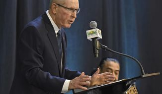 Jacksonville Jaguars new Executive Vice President of Football Operations, Tom Coughlin, speaks during a press conference as team owner Shad Khan, rear, looks on at EverBank Stadium in Jacksonville, Fla., Thursday, Jan. 12, 2017.   (Bob Self/The Florida Times-Union via AP)