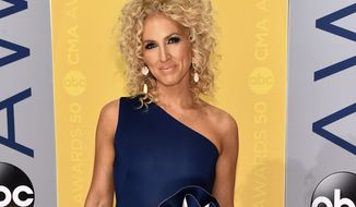 FILE - This Nov. 2, 2016 file photo shows Kimberly Schlapman of Little Big Town at the 50th annual CMA Awards in Nashville, Tenn. On Thursday, Jan. 12, 2017, Schlapman posted a picture of her adopted daughter Dolly Grace on Instagram. Schlapman and her husband Stephen have another daughter, Daisy. (Photo by Evan Agostini/Invision/AP, File)