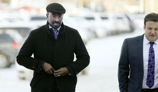 """Van Jones, left, a CNN commentator and family friend who once worked as an environmental adviser to the Obama administration, arrives at the Carver County Justice Center for a hearing on Prince's estate, Thursday, Jan. 12, 2017, in Chaska, Minn. All the musician's siblings want the judge to declare the trust company Comerica as a """"personal representative,"""" or executor, of the estate. But they're divided on whether to name anyone as co-executor. Four of the six siblings back longtime Prince lawyer L. Londell McMillan. But Tyka Nelson and Omar Baker object. (David Joles/Star Tribune via AP)"""