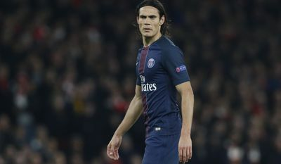 FILE - In this Wednesday, Nov. 23, 2016 file photo, PSG's Edinson Cavani watches play during the Champions League group A soccer match between Arsenal and Paris Saint Germain at the Emirates stadium in London. Paris Saint-Germain coach Unai Emery is looking to recruit a striker in the January transfer to take some pressure off top scorer Edinson Cavani. Cavani has scored 24 goals in all competitions this season, but the only other player scoring regularly is Brazilian winger Lucas, who has 10. (AP Photo/Alastair Grant, file)
