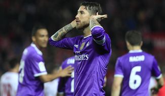 Real Madrid's Sergio Ramos celebrates after scoring against Sevilla during a Spain's King's Cup soccer match between Real Madrid and Sevilla at the Ramon Sanchez Pizjuan stadium, in Seville, Spain on Thursday, Jan. 12, 2017. (AP Photo/Angel Fernandez)