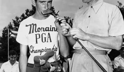 FILE - In this July 9, 1945 file photo Byron Nelson, right, has his caddie, George Gould, kiss his putter for good luck before he teed off in the 27th PGA Championship at Dayton, Ohio. UConn's women's basketball team is on the verge of winning its 91st straight game, which would break its own NCAA Division I record that was set between 2008 and 2010. The streak ranks among the most impressive in sports. Byron Nelson dominated the PGA Tour in 1945, winning 18 tournaments, including an unprecedented 11 in a row. (AP Photo/File)