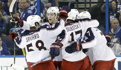 Columbus Blue Jackets right wing Josh Anderson (34) celebrates with teammates, including defenseman David Savard (58) and center Brandon Dubinsky (17), after scoring against the Tampa Bay Lightning during the second period of an NHL hockey game Friday, Jan. 13, 2017, in Tampa, Fla. (AP Photo/Chris O'Meara)