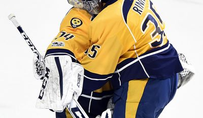 Nashville Predators goalie Juuse Saros, left, is congratulated by teammate Pekka Rinne (35), both from Finland, after beating the Boston Bruins 2-1 in an NHL hockey game Thursday, Jan. 12, 2017, in Nashville, Tenn. (AP Photo/Mark Zaleski)