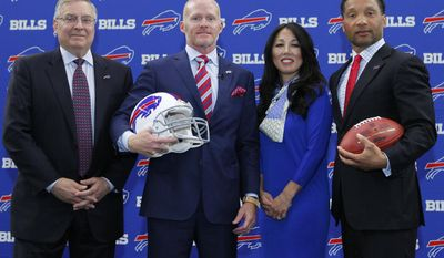 Buffalo Bills NFL football team new head coach Sean McDermott poses for a photograph with team co-owner Terry Pegula, left, co-owner Kim Pegula and team General Manager Doug Whaley during a press conference, Friday, Jan. 13, 2017, in Orchard Park, N.Y. (AP Photo/Jeffrey T. Barnes)