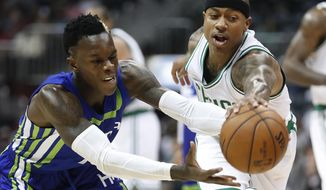Atlanta Hawks guard Dennis Schroder, left, and Boston Celtics guard Isaiah Thomas chase down a loose ball during the first half of an NBA basketball game Friday, Jan. 13, 2017, in Atlanta. (AP Photo/John Bazemore)