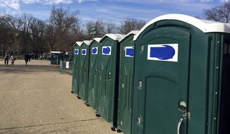 """Portable restrooms, with the name """"Don's Johns"""" covered up, are lined up on Capitol Hill in Washington on Jan. 13, 2017. (Associated Press/Matthew Daly)"""