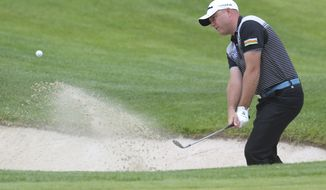 FILE - In this Thursday, July 4, 2013 file photo, Graeme Storm of England chips out of the bunker on the first day of the French Open Golf tournament at Paris National course in Guyancourt, west of Paris. Graeme Storm jumped into a two-stroke lead at the top of the leaderboard Friday, Jan. 13, 2017 after shooting a course record 9-under 63 at the Glendower Golf Club. Storm had nine biridies and leads Peter Uihlein (64), overnight leader Trevor Fisher Jr. (68) and Jbe Kruger (67) by two. (AP Photo/Michel Euler, file)
