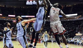 Houston Rockets forward Montrezl Harrell (5) and Memphis Grizzlies forward JaMychal Green (0) fight for a rebound as Marc Gasol (33) and Mike Conley (11) look on in the first half of an NBA basketball game, Friday, Jan. 13, 2017, in Houston. (AP Photo/Eric Christian Smith)