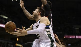 Milwaukee Bucks' Matthew Dellavedova drives against the Miami Heat during the second half of an NBA basketball game Friday, Jan. 13, 2017, in Milwaukee. (AP Photo/Jeffrey Phelps)