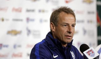 FILE - In this Nov. 12, 2015, file photo, U.S. men's soccer coach Jurgen Klinsmann takes part in a news conference in St. Louis. Klinsmann is proud of his half-decade in charge of the U.S. national team, and he believes he left successor Bruce Arena in a position to make the Americans even better.Klinsmann made his first public remarks since his firing when he spoke Friday at a convention of the National Soccer Coaches Association of America in Los Angeles. (AP Photo/Jeff Roberson, file)