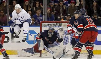 Toronto Maple Leafs center Leo Komarov (47) leaps as a teammate shoots against New York Rangers goalie Henrik Lundqvist (30) during the second period of an NHL hockey game, Friday, Jan. 13, 2017, in New York. (AP Photo/Julie Jacobson)