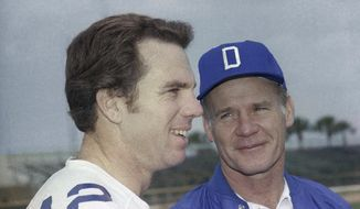 "FILE - This is a Jan. 17, 1979, file photo showing Dallas Cowboys quarterback Roger Staubach with coach Tom Landry. All these years later, Roger Staubach remembers quite clearly what his initial reaction was when Landry approached him about making the shotgun formation a recurring feature of their offense. ""I thought he was crazy or something,"" the former quarterback said with a snicker during a telephone interview this week  (AP Photo/File)"