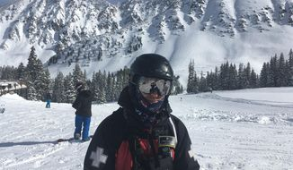 Snow Safety Patroller Ryan Evanczyk stands on the mountainside at Arapahoe Basin ski area, where he works, Thursday, Jan. 12, 2017, in Arapahoe, Colo. Evanczyk has had his hands full lately performing avalanche mitigation, given the large amount of recent snowfall. (AP Photo/P. Solomon Banda)