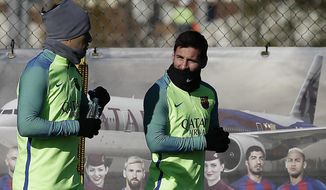 FC Barcelona's Lionel Messi, right, and Luis Suarez attend a training session at the Sports Center FC Barcelona Joan Gamper in Sant Joan Despi, Spain, Friday, Jan. 13, 2017. FC Barcelona will play against Las Palmas in a Spanish La Liga on Saturday. (AP Photo/Manu Fernandez)