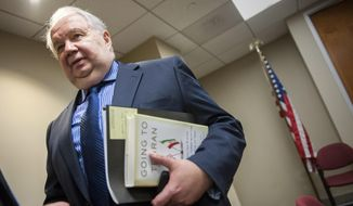 In this Sept. 6, 2013, file photo, Russia's ambassador to the U.S. Sergey Kislyak, speaks with reporters in Washington. (AP Photo/Cliff Owen, File)