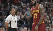 Cleveland Cavaliers forward LeBron James, right, reacts after being called for a technical foul by referee Bill Kennedy, left, during the first quarter of an NBA basketball game against the Sacramento Kings, Friday, Jan. 13, 2017, in Sacramento, Calif. (AP Photo/Rich Pedroncelli)