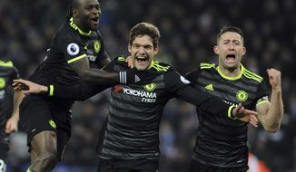 Chelsea's Marcos Alonso, centre, celebrates scoring his second goal during the English Premier League soccer match between Leicester City and Chelsea at the King Power Stadium in Leicester, England, Saturday, Jan. 14, 2017. (AP Photo/Rui Vieira)