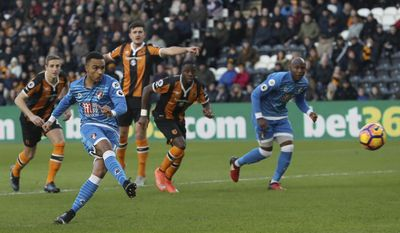 AFC Bournemouth's Junior Stanislas, left, scores his side's first goal of the game during their English Premier League soccer match against Hull at The KCOM Stadium, Hull, England, Saturday, Jan. 14, 2017(Danny Lawson/PA via AP)