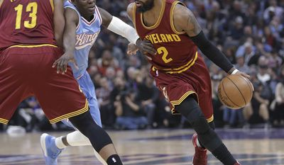 Sacramento Kings guard Darren Collison, center, tries to fight through the pick set by Cleveland Cavaliers center Tristan Thompson, left, as he tries to guard Cavaliers guard Kyrie Irving during the first quarter of an NBA basketball game Friday, Jan. 13, 2017, in Sacramento, Calif. (AP Photo/Rich Pedroncelli)