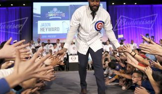 Jayson Hayward is introduced at the Chicago Cubs' annual baseball fan convention Friday, Jan. 13, 2017, in Chicago. (AP Photo/Charles Rex Arbogast)