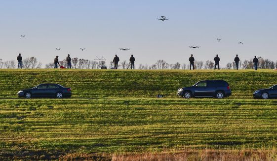 In this Oct. 9, 2016 photo, drone pilots for SkySkopes, a Grand Forks, N.D. company that became the first business in the state legally approved by the Federal Aviation Administration to fly unmanned aircraft for business purposes, gather at a practice airfield.  With the number of commercial drone operations outpacing the pool of certified drone pilots, experts say more training is needed to help young flyers operate the planes legally and safely.  (Brandi Jewett/SkySkopes Academy via AP)