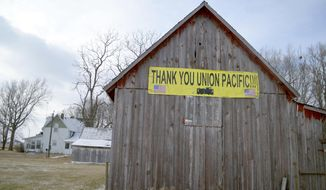 ADVANCE FOR SATURDAY JAN 14 AND THEREAFTER - This this Jan. 5, 2017 photo shows a barn of the property of Vernice Gloyer Ankerstjerne, of Onawa, Iowa, daughter of the late Vernon and Lenora Gloyer. She placed this banner on a barn serving her parents' old farmstead north of Whiting, Iowa. The Gloyers were big fans of the Union Pacific Railroad, which ran immediately east of their farm.  (Tim Gallagher/Sioux City Journal via AP)