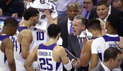 TCU head coach Jamie Dixon makes a point to his team during a timeout in the second half of an NCAA college basketball game against Iowa State, Saturday, Jan. 14, 2017 in Fort Worth, Texas (Paul Moseley/Star-Telegram via AP)