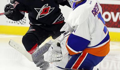 New York Islanders goalie Thomas Greiss (1) comes out to challenge Carolina Hurricanes' Jeff Skinner (53) for the puck during the second period of an NHL hockey game, Saturday, Jan. 14, 2017, in Raleigh, N.C. (AP Photo/Karl B DeBlaker)