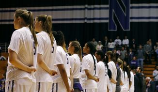 Northwestern women's NCAA college basketball players, all wearing the jersey number of teammate Jordan Hankins, take part in a pregame ceremony at the Welsh Ryan Arena in Evanston, Ill., Saturday, Jan. 14, 2017. Hankins, 19, a sophomore from Indianapolis, was found dead in her room earlier in the week. (Jim Young/Chicago Tribune via AP)
