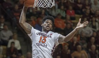 Virginia Tech guard Ahmed Hill (13) grabs a rebound against Notre Dame during the first half of an NCAA college basketball game Saturday, Jan 14, 2017, at Cassell Coliseum in Blacksburg, Va. Notre Dame won 76-71. (AP Photo/Don Petersen)