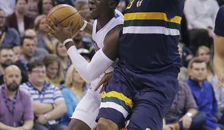 Detroit Pistons guard Reggie Jackson, left, drives as Utah Jazz center Boris Diaw defends during the first half of an NBA basketball game Friday, Jan. 13, 2017, in Salt Lake City. (AP Photo/Rick Bowmer)