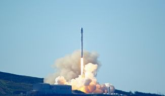 Space-X's Falcon 9 rocket with 10 satellites  launches at Vandenberg Air Force Base, Calif. on Saturday, Jan. 14, 2017.  The two-stage rocket lifted off  to place 10 satellites into orbit for Iridium Communications Inc.  About nine minutes later, the first stage returned to Earth and landed successfully on a barge in the Pacific Ocean south of Vandenberg.  (Matt Hartman via AP)