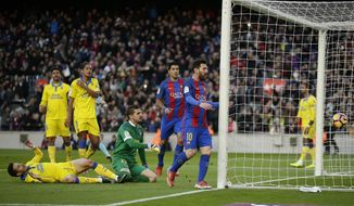 FC Barcelona's Lionel Messi, center, celebrates after scoring during the Spanish La Liga soccer match between FC Barcelona and Las Palmas at the Camp Nou in Barcelona, Spain, Saturday, Jan. 14, 2017. (AP Photo/Manu Fernandez)