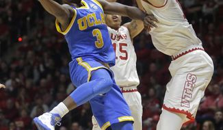 UCLA guard Aaron Holiday (3) goes to the basket as Utah forward David Collette, right, defends during the first half of an NCAA college basketball game Saturday, Jan. 14, 2017, in Salt Lake City. (AP Photo/Rick Bowmer)