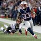 New England Patriots running back Dion Lewis had three touchdowns in an AFC playoff victory on Saturday against the Houston Texans. The Patriots will play in the AFC title game for a record sixth straight year and 11th time in 16 seasons. (Associated Press)