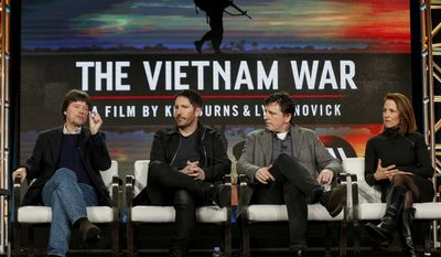 """Ken Burns, from left, Trent Reznor, Atticus Ross and Lynn Novick speak at PBS' """"The Vietnam War"""" panel at the 2017 Television Critics Association press tour on Sunday, Jan. 15, 2017, in Pasadena, Calif. (Photo by Willy Sanjuan/Invision/AP)"""